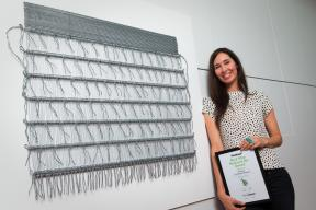 Consecutive Fieldays No. 8 Wire National Art Award finalist Cherise Thomson with her work Korowai which placed second in 2